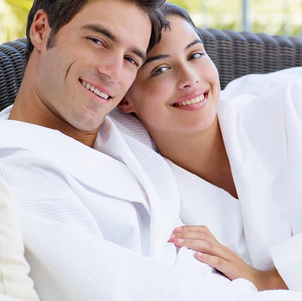 Couples in hotel bathrobes